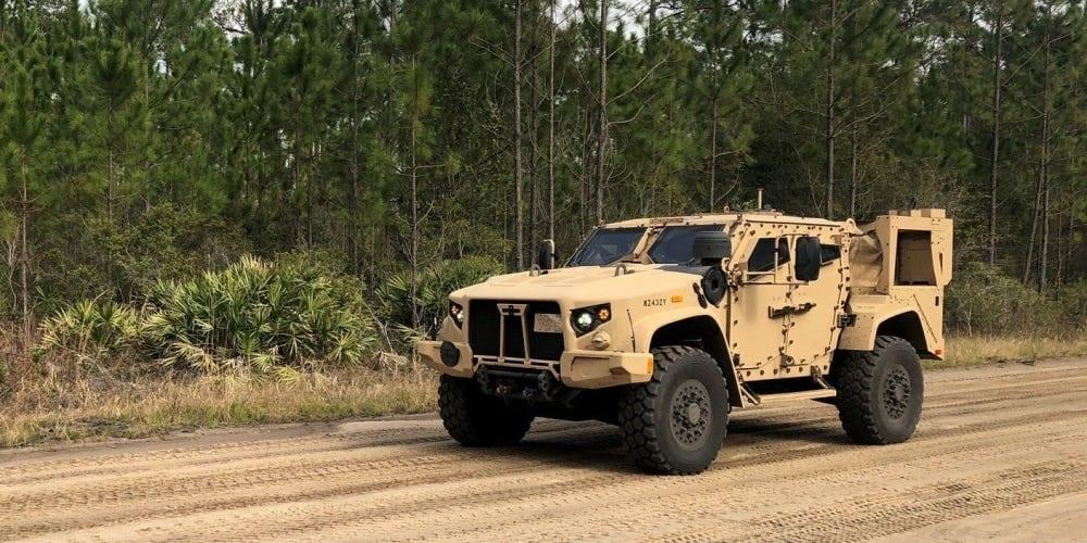 All terrain beige vehicle that looks like a military hummer